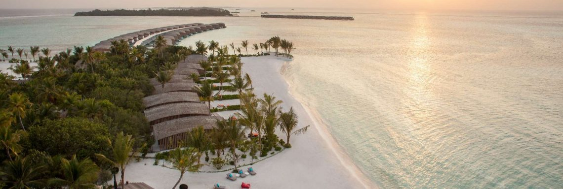Club Med Villas in FInolhu, Maldives - Aerial view of the beach with the villas in front of the lagoon at sunset