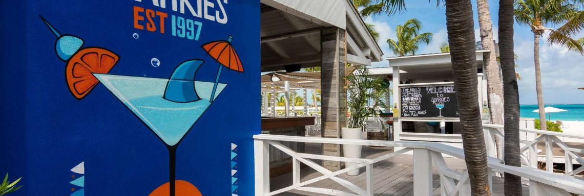 This snack bar is located by the white, open sand beach.