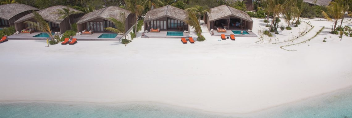 Club Med Kani, Maldives - Aerial view of the villas with their furnished terrace and beach