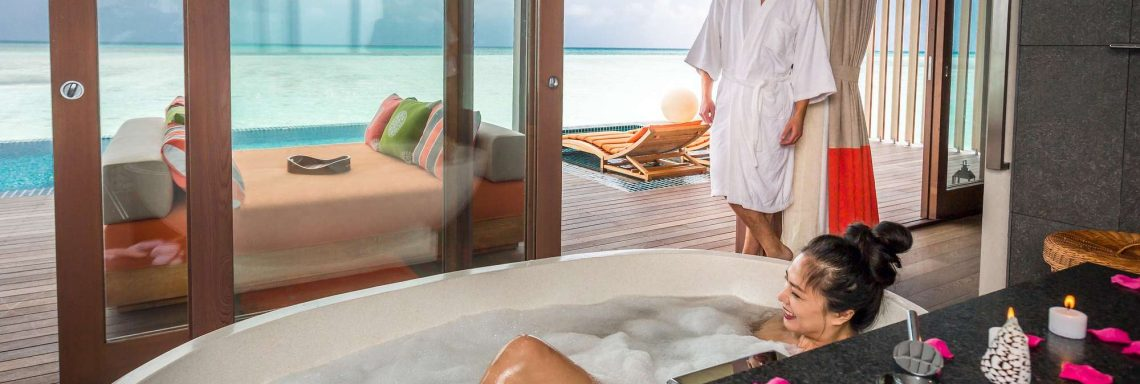 Club Med Villas in FInolhu, Maldives - Photo of two people in the bathroom of a villa
