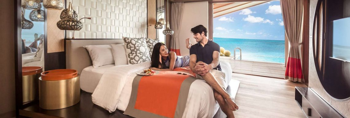Club Med Villas in FInolhu, Maldives - Photo of a couple in a room of a villa with a view of the lagoon