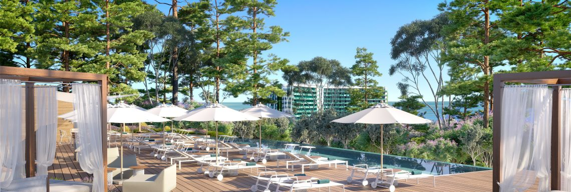 Club Med Magna Marbella - View of the wooden terrace and deckchairs.