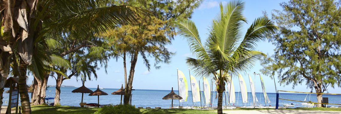 Club Med Pointe aux cannoniers, Mauritius - Outdoor gardens with sailboats and catamaran in the distance