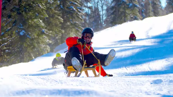 club_med_quebec_resorts_LeMassif_Winter_Massif_all-inclusive-ski-resort-sled