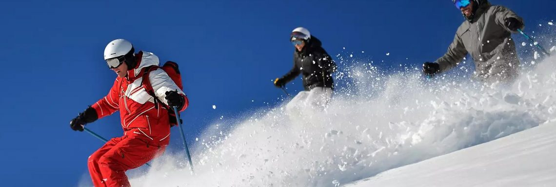 Club Med Alpes d'Huez in France - A G.S is helping is learning group by giving them ski lessons