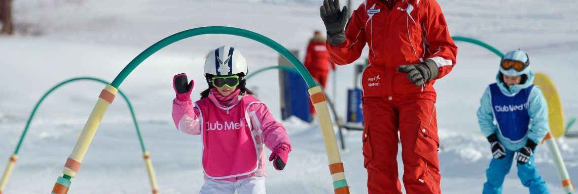 Club Med Alpes d'Huez in France - Image of a child with her G.S learning how to ski