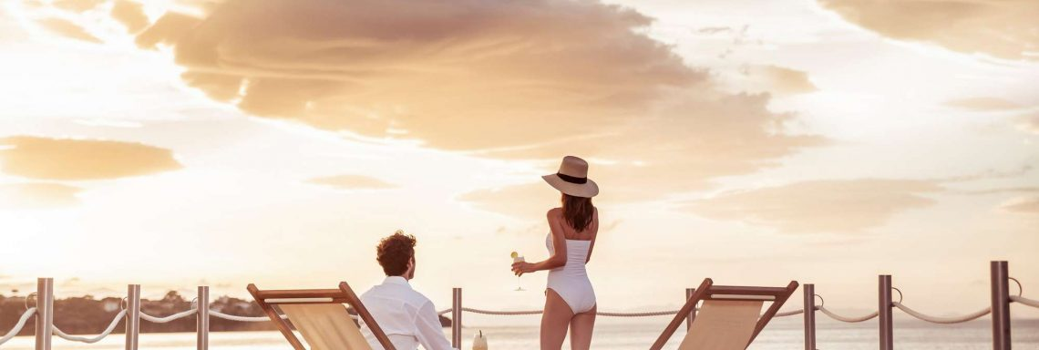 Club Med Cefalù in Italy - A couple enjoy the sunset on one of the complex terrace