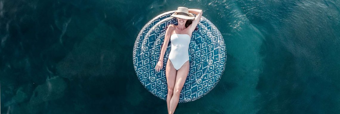 Club Med Cefalù in Italy - A woman is relaxing on her tube in the ocean