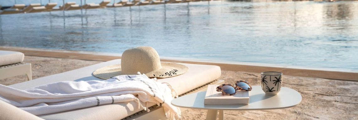 Club Med Cefalù in Italy -  A deck chair on the ledge of the pool