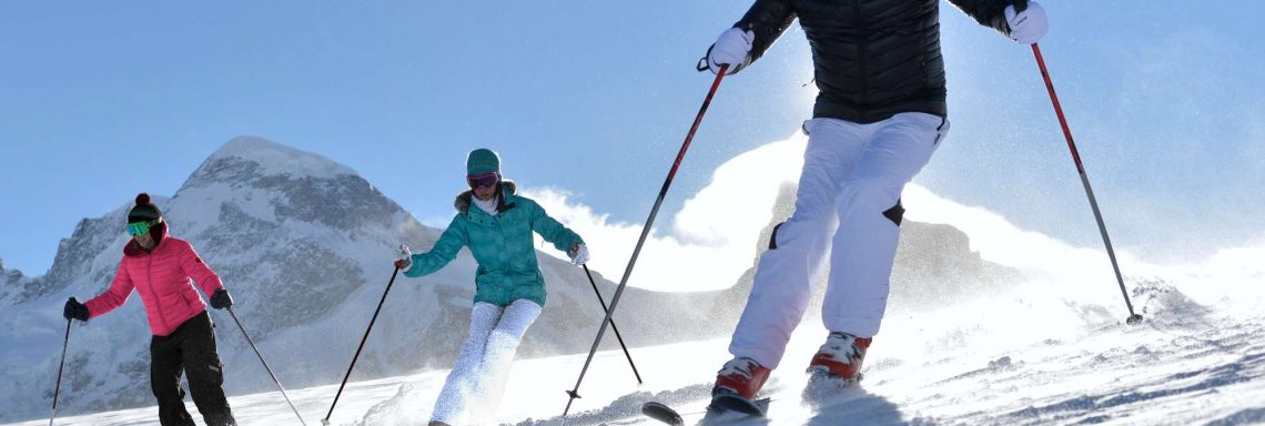 Club Med Cervinia, Italy - Two people are praticing a ski activity on the mountain top