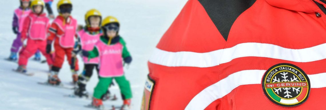 Club Med Cervinia, Italy - A G.S is helping kids learning ski at the caretaking