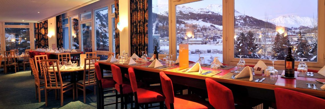 Club Med Saint-Morizt Roi Soleil, Switzerland - Interior photo of the main restaurant wich led to a view of the valley