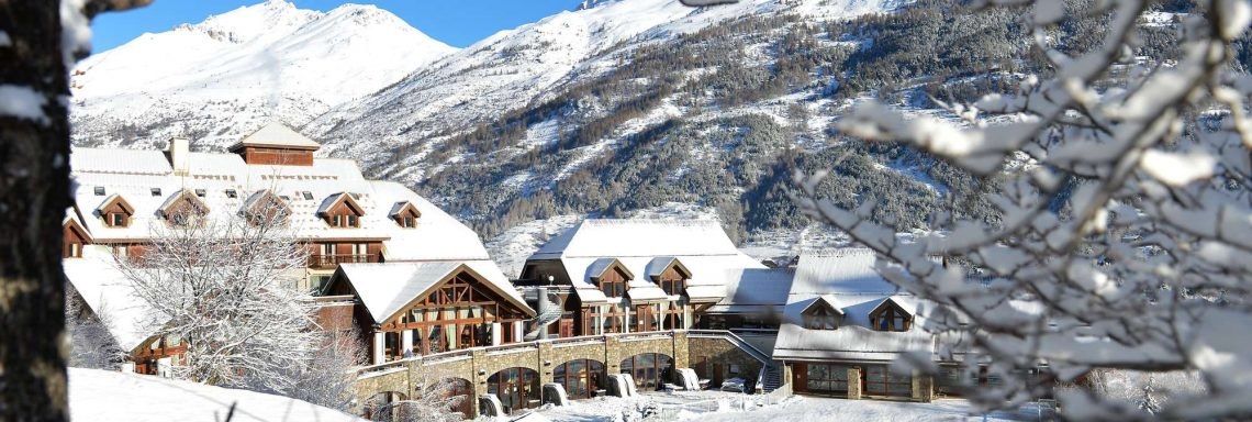 Club Med Serre-Chevalier, France - Snow-covered exterior view of Club Med on the mountainside