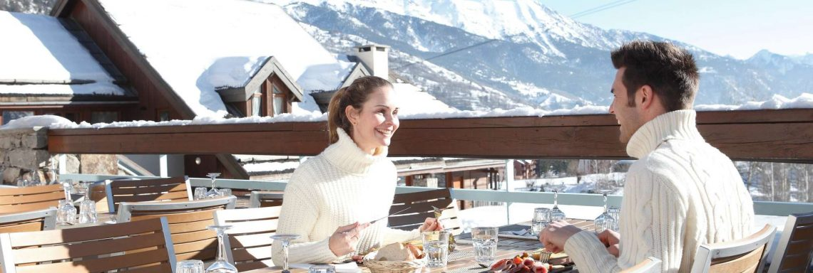 Club Med Serre-Chevalier, France - Image of a couple enjoying a meal break outdoors