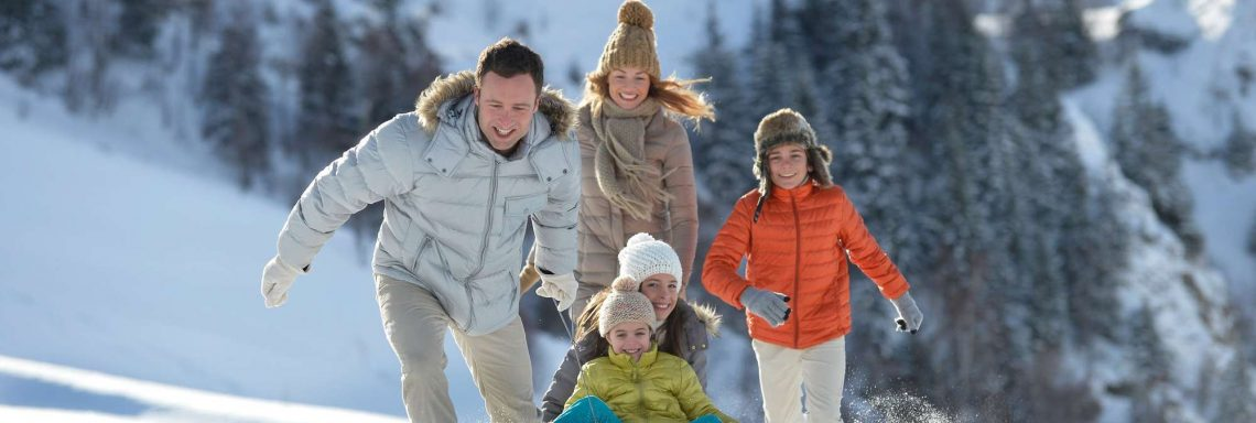 Club Med Valmorel, France - Image of a family playing in the snow
