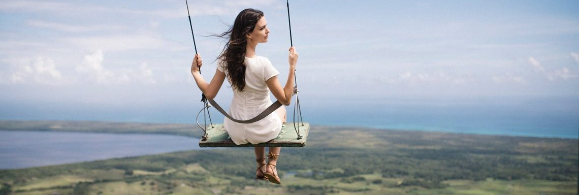 Club Med Miches Playa Esmeralda, Dominican Republic - Woman swing top of mountain