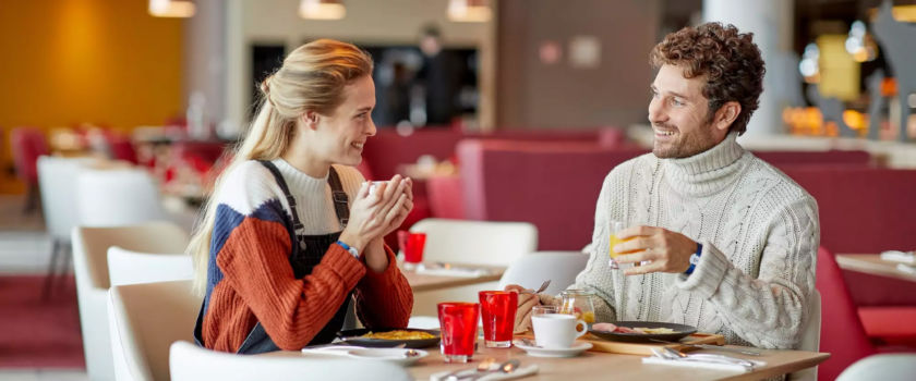 Club Med Arcs Panorama, in France - A couple enjoys a diner, in one of the complex restaurants