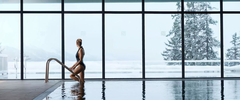 Club Med Arcs Panorama, France - View of a woman using one of the complex's indoor heated pools