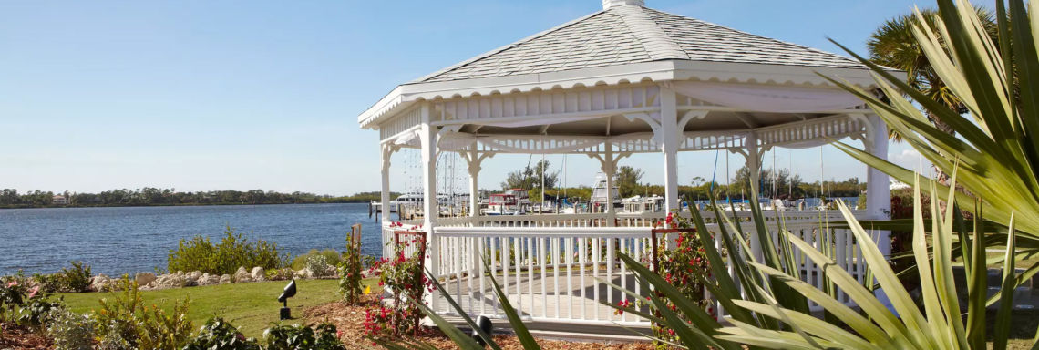 Club Med Sandpiper Bay, Florida- Picture of an exterior veranda made of wood in front of the sea