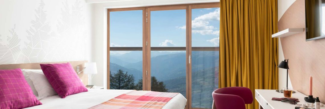 Interior of a double room with mountain view