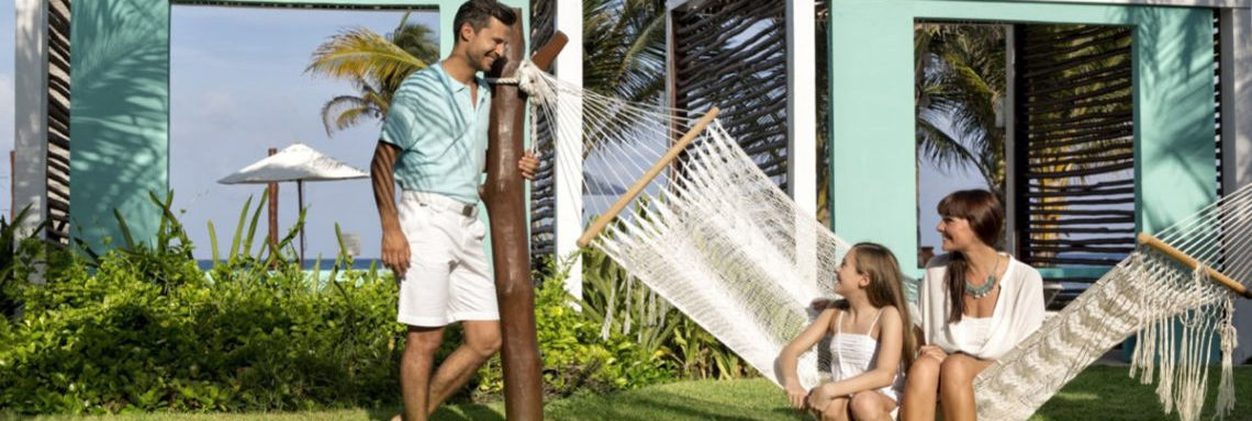 Club Med Cancun Yucatan, Mexico - A family takes a moment to rest in a hammock