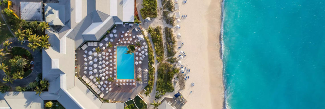 Club Med Columbus Isle, Bahamas - Overhead and aerial view of the heart of the Village with the pool