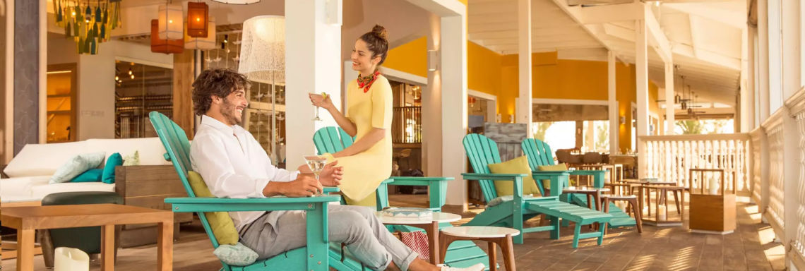 Club Med Columbus Isle, Bahamas - Couple enjoying one of the resort's outdoor terraces