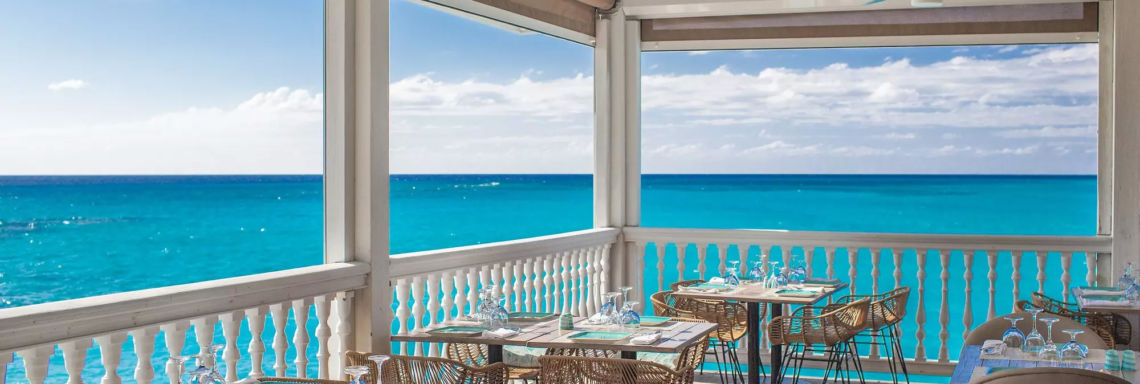 Club Med Columbus Isle, Bahamas - Photo of a restaurant's outdoor patio overlooking the sea