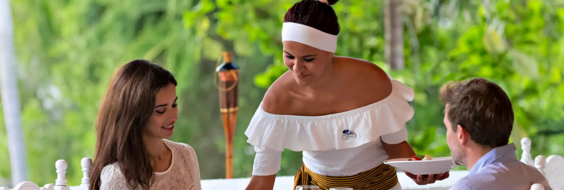 Club Med Ixtapa Pacific, Mexico - Image of waitress bringing meal of couple