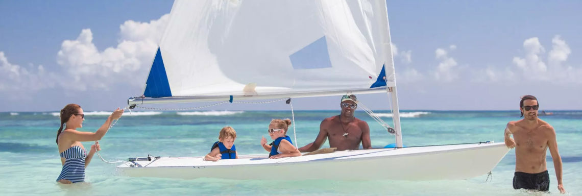 Club Med Punta Cana, Dominican Republic - A family has just completed a windsurfing activity in the sea